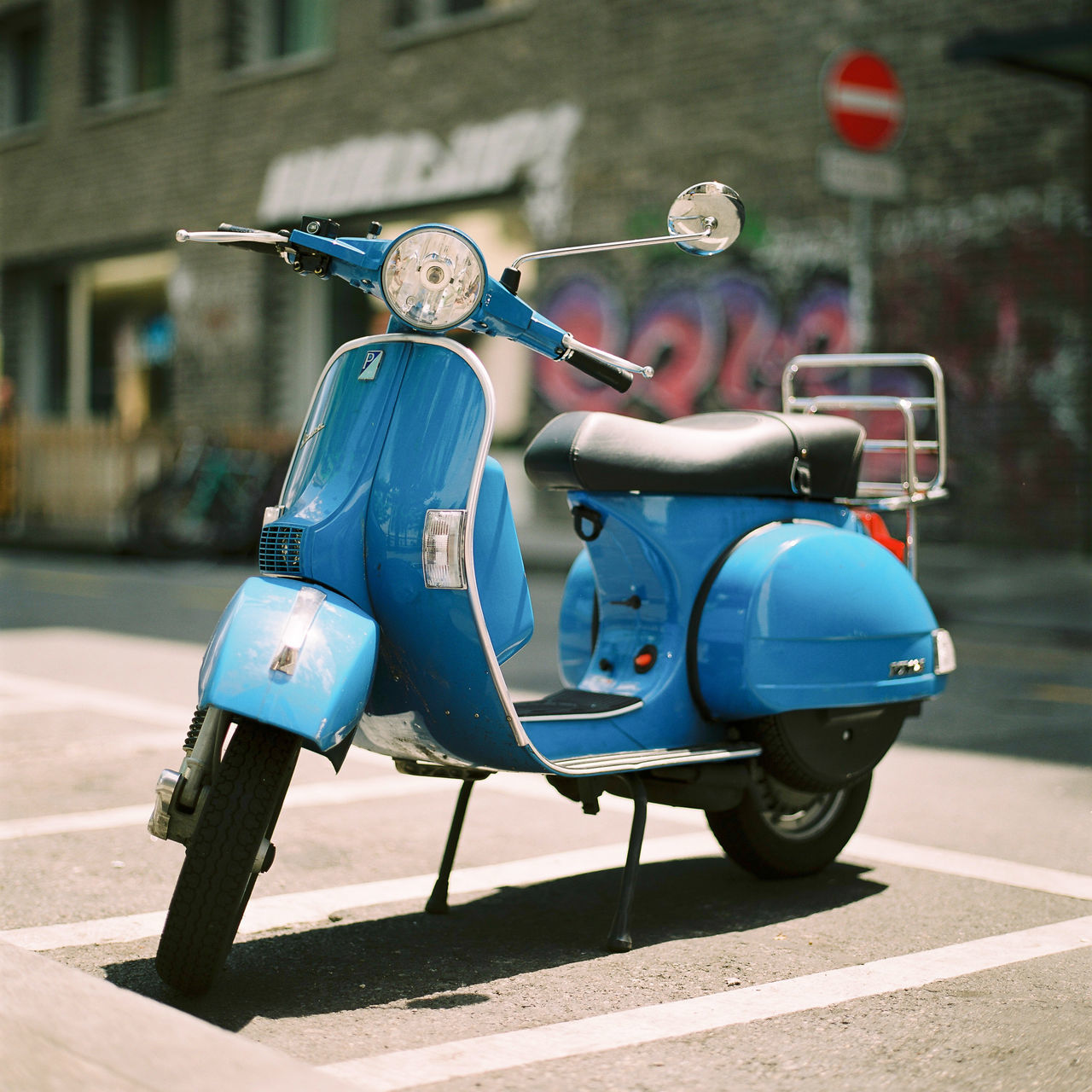 A vespa in Geneva's town centre. Afternoon Bike Blue Bokeh Day Geneva Geneve Geneve, Switzerland Hasselblad Mode Of Transport Motorcycle No People Outdoors Park Scooter Stationary Street Summer Switzerland Transportation Ve