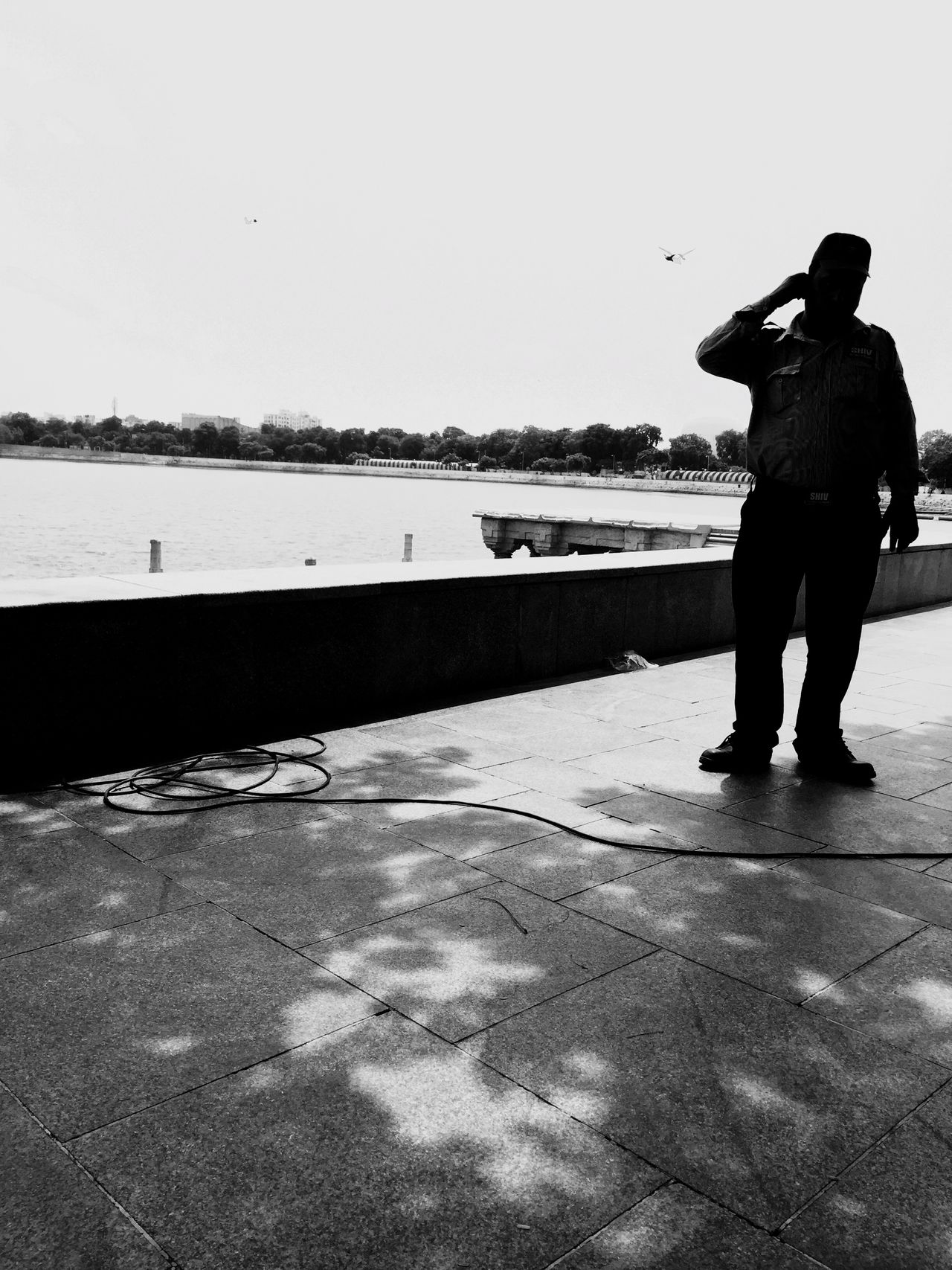 Shades Of Grey A typical guard on duty. Irritated with the heat. The body has succumbed to the unhealthy lifestyle of eating out resulting in the baggy tummy! Peace And Quiet Lovely Weather Lake View Unhealthy