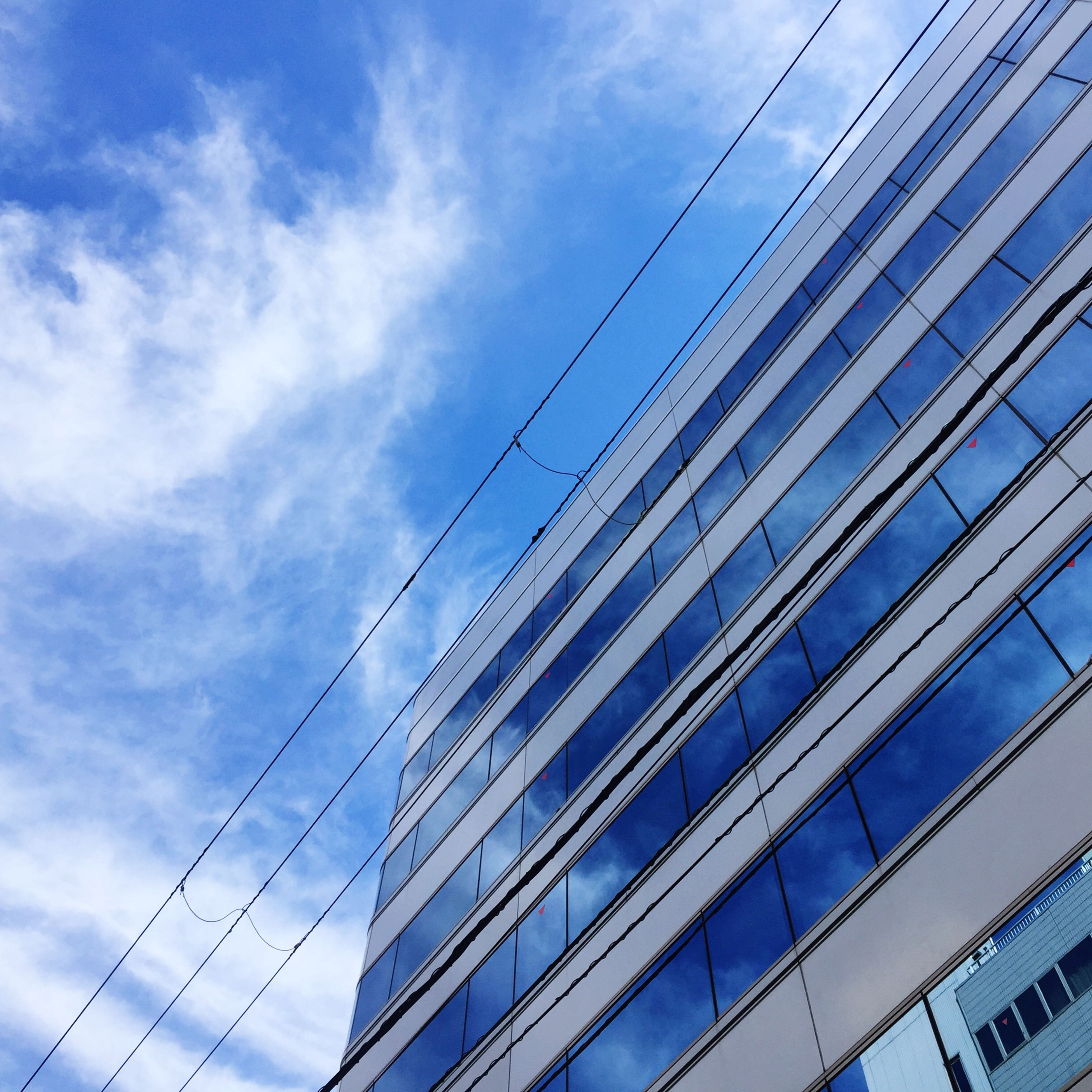 architecture, low angle view, built structure, building exterior, sky, modern, office building, city, skyscraper, tall - high, cloud - sky, building, tower, day, cloud, outdoors, glass - material, no people, reflection, tall