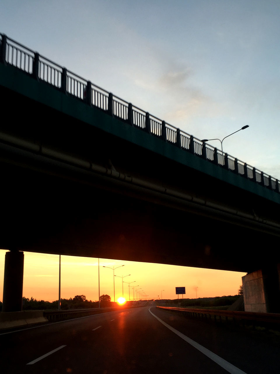 transportation, bridge - man made structure, sunset, connection, architecture, built structure, road, rail transportation, sky, low angle view, sun, train - vehicle, mode of transport, public transportation, bridge, outdoors, land vehicle, silhouette, no people, day