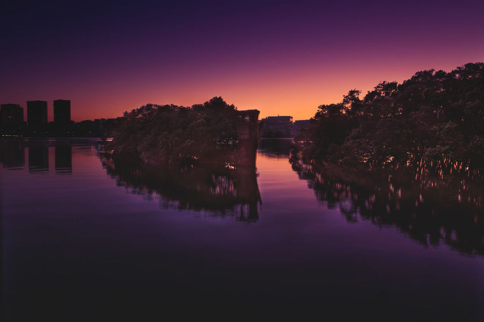 The shipwreck SS Ayrfield , Homebush Bay, Sydney, Australia Reflection Water City Travel Sky Symmetry Landscape Architecture Travel Destinations Scenics Silhouette Outdoors Reflection Lake Urban Skyline Nature Cityscape Travel Photography Shipwreck Abandonded Rustic Sunrise Purple Sky Orange Sky Mangroves Sydney, Australia EyeEmNewHere