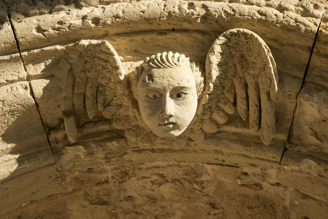 Angel Ancient Ancient Civilization Angel Art And Craft Bas Relief Basrelief Close-up Day Historic Historical Nature No People Old Outdoors Religion Sculpture Statue Sunlight