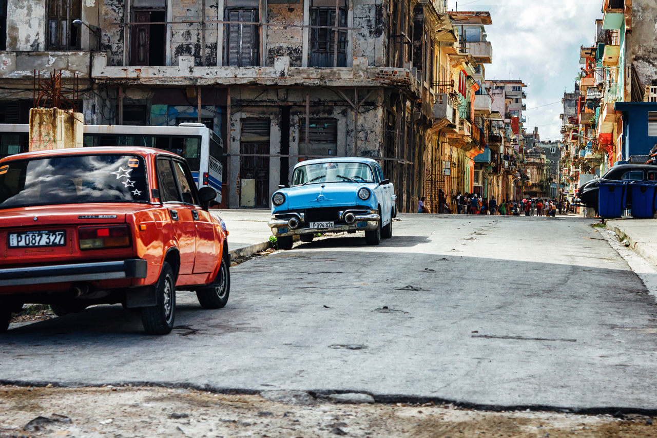 Architecture Building Exterior Built Structure Car City City Life Classic Car Cuba Collection Cuban Life Land Vehicle Lifestyle Mode Of Transport No People Old Car Old Havana Outdoors Poverty Road Street Transportation