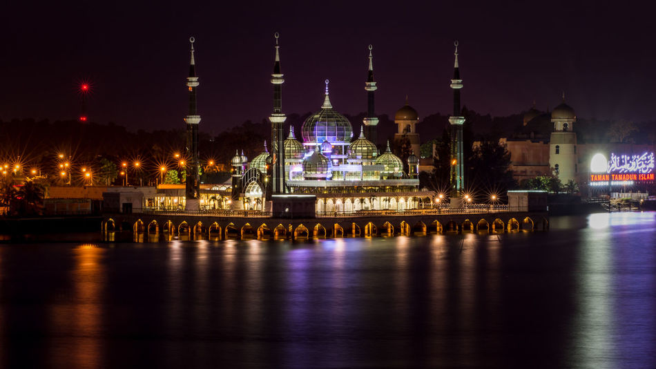 A night time photo of the stunning Crystal Mosque (known locally as Masjid Kristal) in Kuala Terengganu, Malaysia. Architecture City Cityscape Dome Floating Floating Mosque Illuminated Impressive Islam Islamic Architecture Kuala Terengganu Landmark Light Effect Long Exposure Malaysia Muslim Night Outdoors Place Of Worship Place Of Worship Reflection Sky Stilts Travel Destinations Water