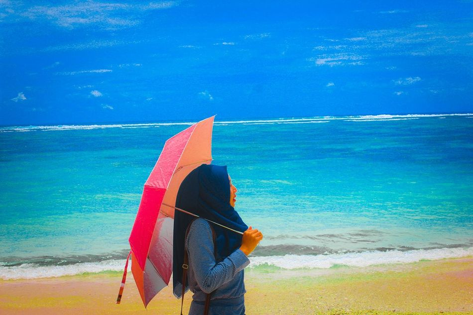 Holiday in Bali Beach Sea Beach Blue Sand Leisure Activity Only Women Vacations Horizon Over Water Water Lifestyles