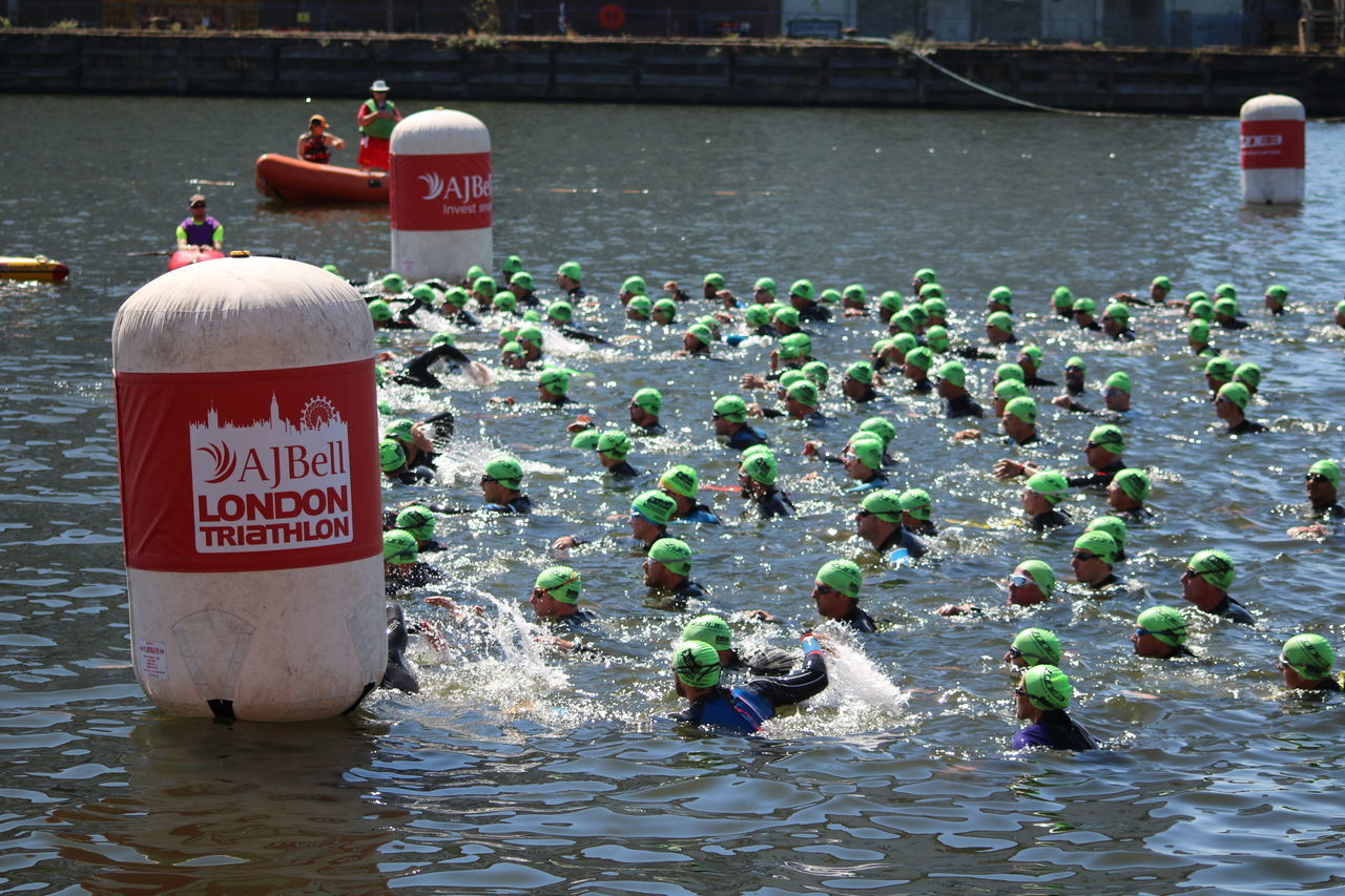 Day Floating On Water London Docklands London Triathlon Outdoors People Real People River Splash Starting Line Swim Start Swimming Triathletes Water
