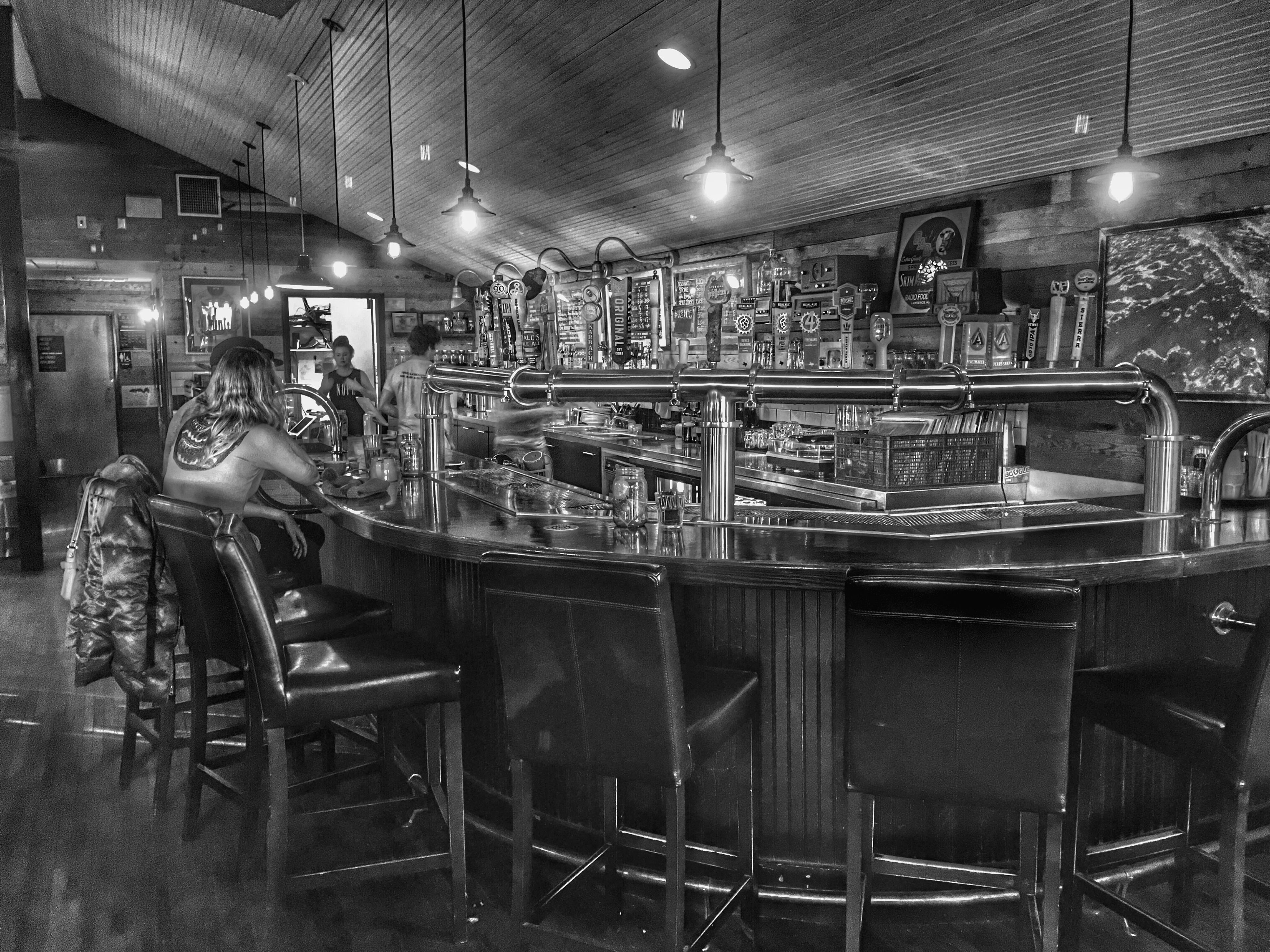 indoors, illuminated, retail, men, large group of objects, store, restaurant, shop, food and drink, night, for sale, lifestyles, table, chair, incidental people, sitting, arrangement, small business