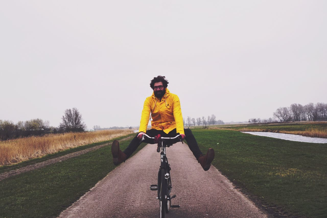 One Person Yellow Tree Only Men One Man Only Bicycle Cycling Healthy Lifestyle Leisure Activity Full Length Clear Sky Day Sport Outdoors Men Real People Sports Clothing Adults Only Athlete Travel Happy Happy People Happiness Transportation