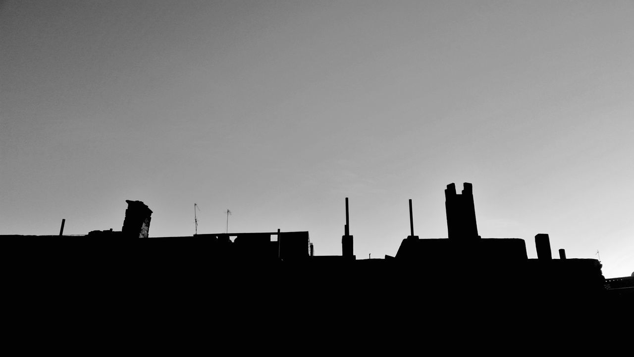 silhouette, built structure, copy space, architecture, low angle view, building exterior, clear sky, smoke stack, outdoors, sky, no people, sunset, factory, day, nature