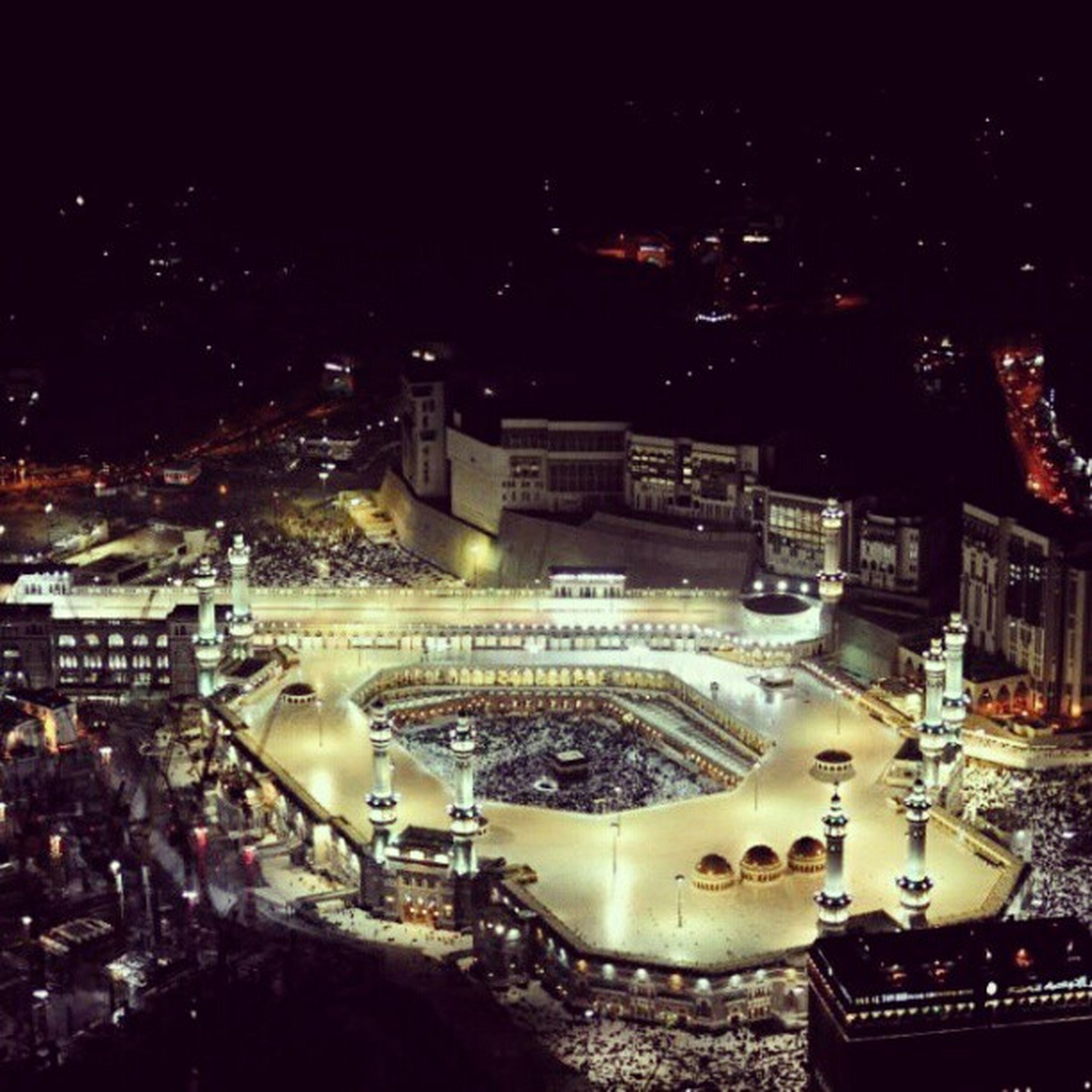 illuminated, city, night, cityscape, architecture, high angle view, building exterior, built structure, crowded, city life, travel destinations, outdoors, capital cities, no people, residential building, residential district, elevated view, travel, aerial view