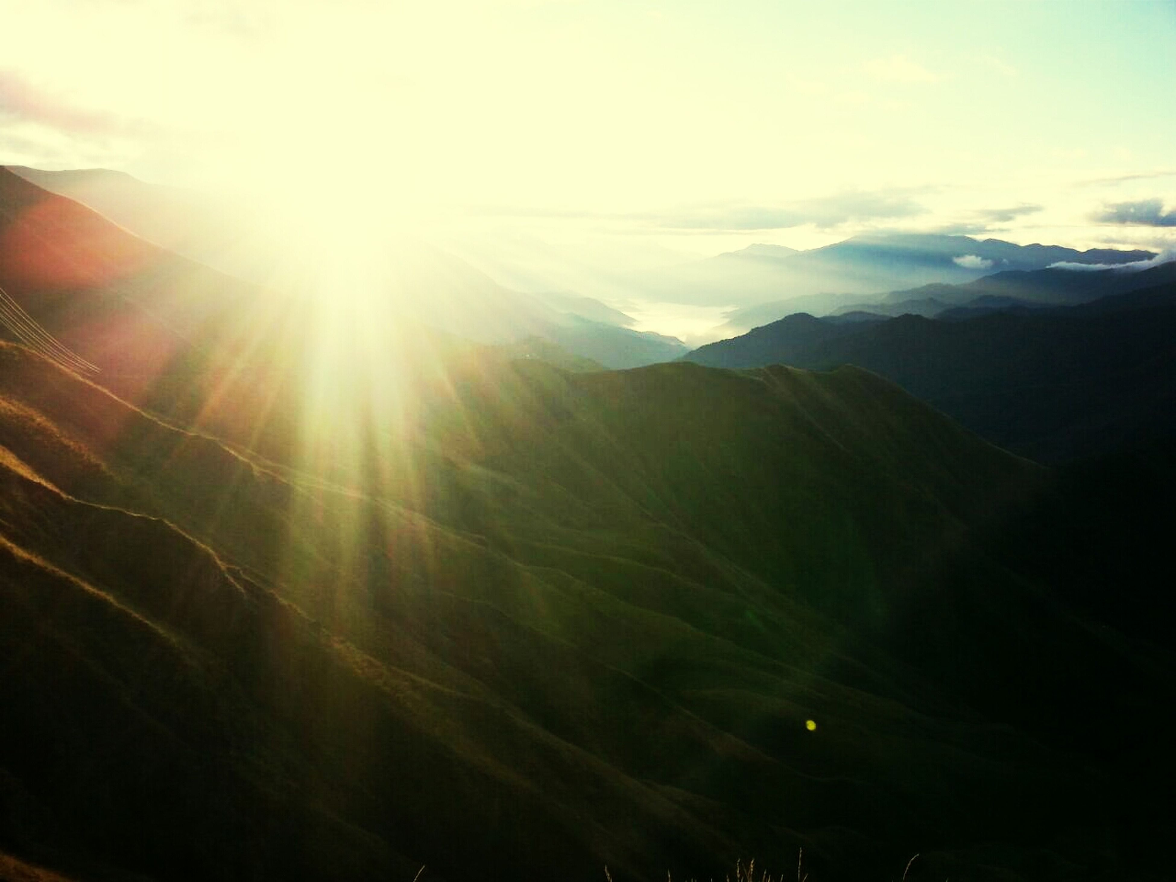 sun, mountain, sunbeam, lens flare, scenics, tranquil scene, tranquility, mountain range, beauty in nature, sunlight, sky, landscape, nature, idyllic, bright, cloud - sky, non-urban scene, sunny, cloud, outdoors