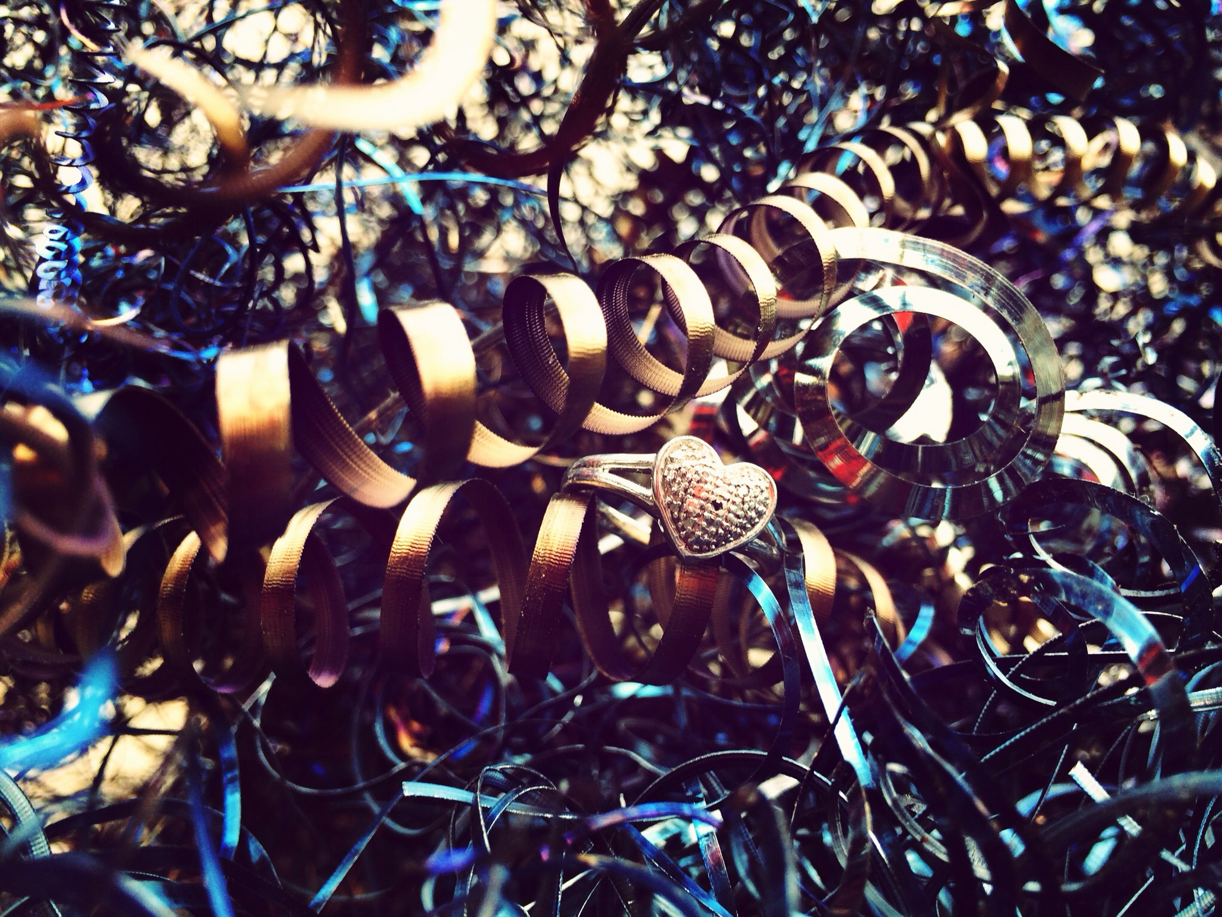full frame, backgrounds, abundance, large group of objects, close-up, metal, pattern, metallic, day, no people, outdoors, selective focus, detail, nature, repetition, focus on foreground, sunlight, textured, complexity, high angle view