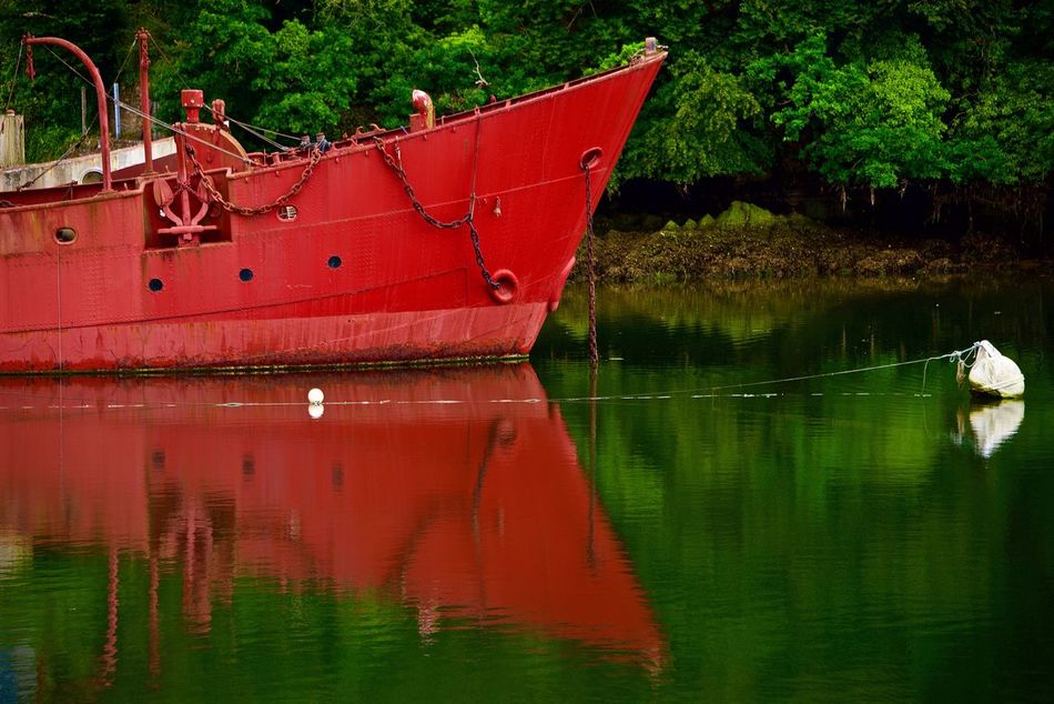 Scareweather Bateau Feu Beauty In Nature Boat Day Douarnenez, Brittany, France Feel The Journey Lightboat Nature No People Non-urban Scene Outdoors Red Reflection River Scareweather Standing Water Tranquil Scene Tranquility Tree Water Waterfront Showcase June Colour Of Life