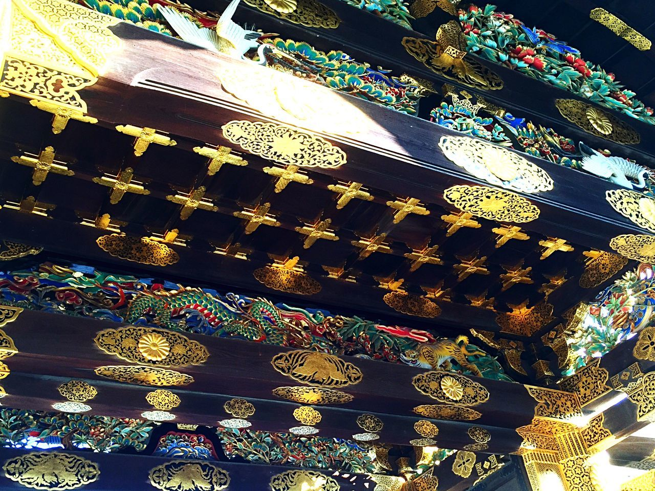 design, ornate, art and craft, low angle view, multi colored, religion, cultures, no people, pattern, spirituality, gold colored, indoors, place of worship, tradition, hanging, travel destinations, day, close-up, architecture