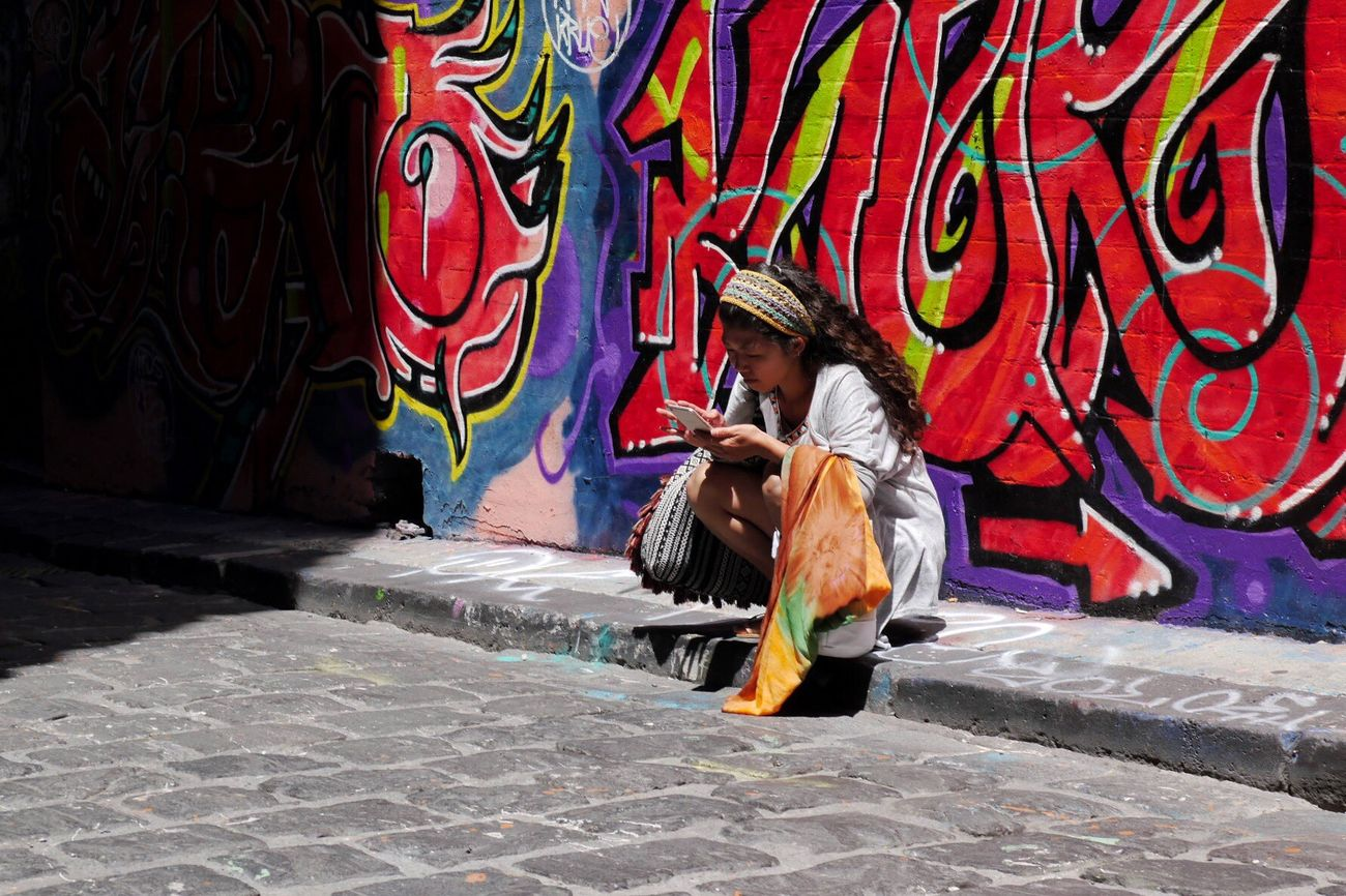 Mobile Conversations Art And Craft Graffiti Street Art Lifestyles One Woman Only City Multi Colored Capturing Movement Australia Streetphotography Street Photography Streetphotography Summer Memories 🌄