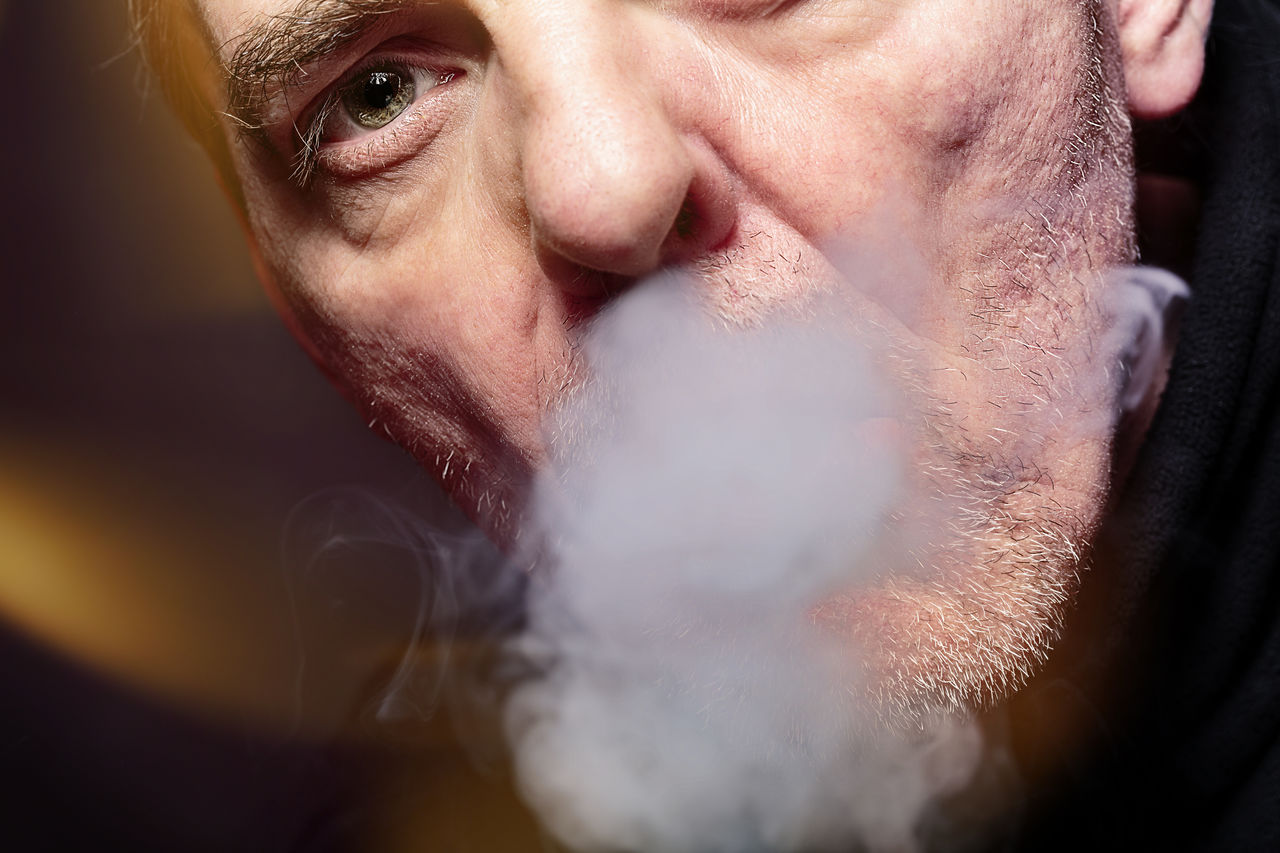 close up portrait of a man smoking an e-cigarette Bokeh Cigarette  Close-up E-Cigarette Ecig Ecigs Equipment Health Inhale Lifestyles Lights Male Man Modern Mouth Nicotine Portrait Smoke Smoking Studio Shot Technology Vapes Vapor