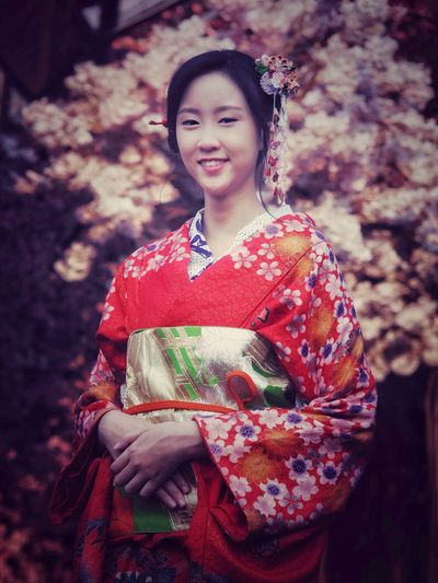 beautiful woman with red kimono dress in Cherry blossom garden on spring Kimono Dress Japanese Culture Japanese Style Cherry Blossom Garden Japan Tourism Obi Kanzashi Flower Portrait Of A Woman Woman In Kimono One Person Portrait Looking At Camera Traditional Clothing Smiling People Standing Kimono Outdoors Only Women Beautiful Woman