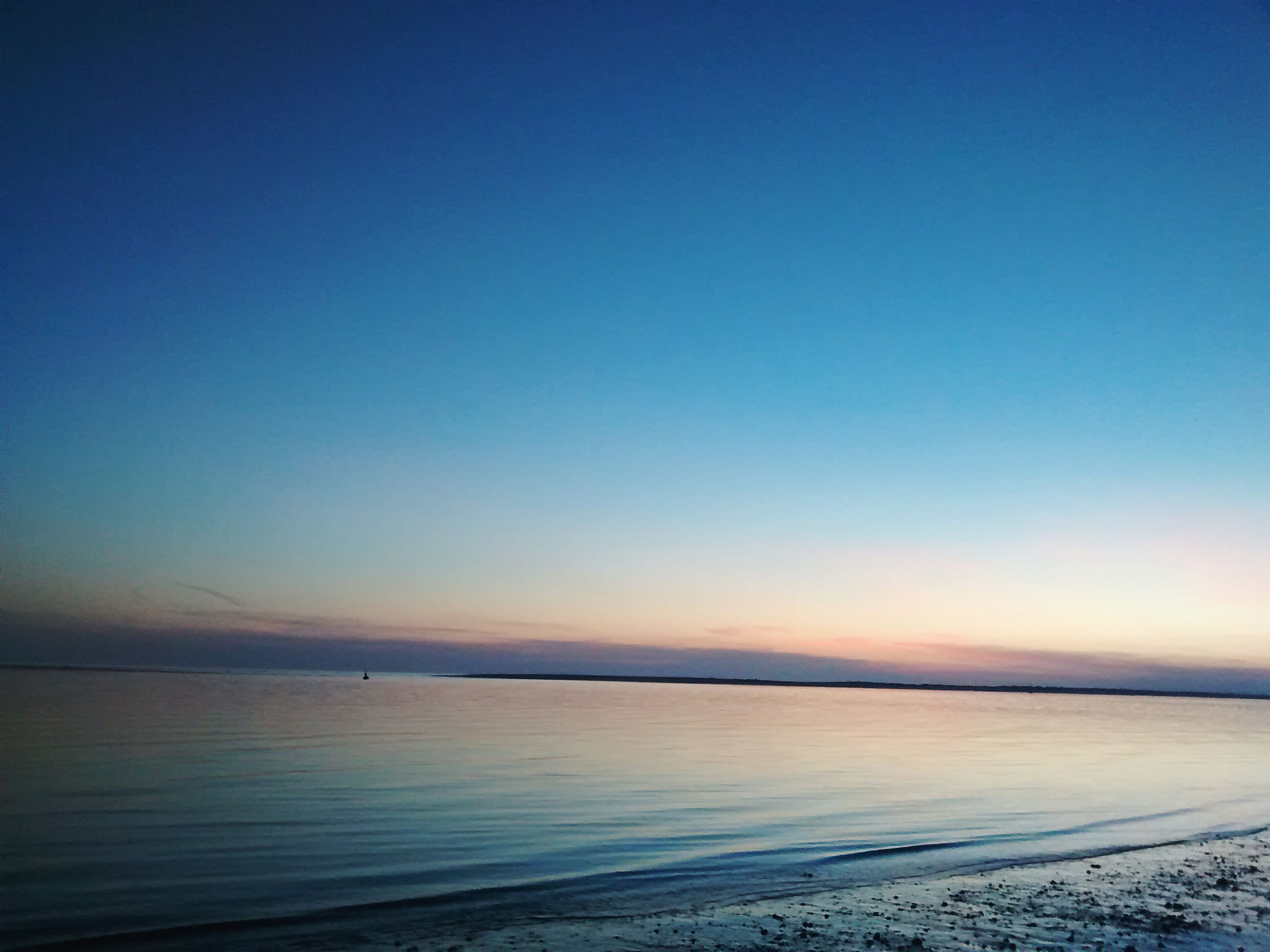 sea, tranquil scene, water, tranquility, scenics, beach, horizon over water, beauty in nature, copy space, nature, shore, blue, sunset, sand, sky, idyllic, clear sky, dusk, remote, non-urban scene