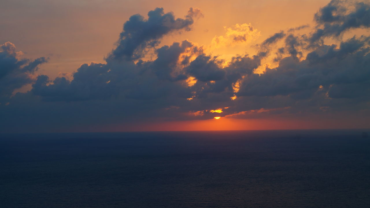 sunset, tranquility, scenics, sea, beauty in nature, tranquil scene, sky, nature, idyllic, horizon over water, majestic, cloud - sky, dramatic sky, water, no people, outdoors, day