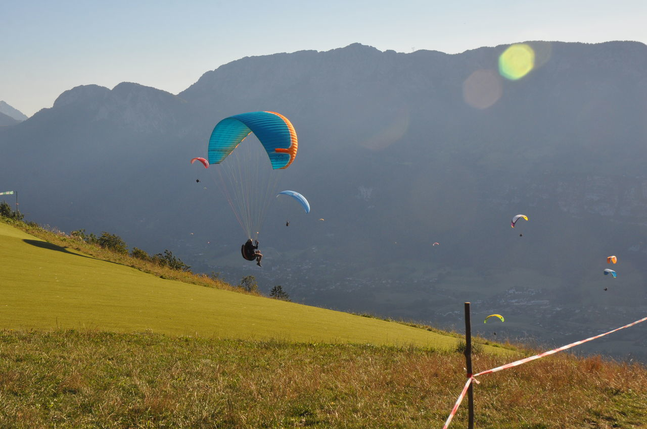 Adventure Beauty In Nature Day Extreme Sports Flying Freedom Hot Air Balloon Landscape Mid-air Mountain Mountain Range Multi Colored Nature One Person Outdoors Paragliding People Scenics Sky Sport Travel Destinations Vacations