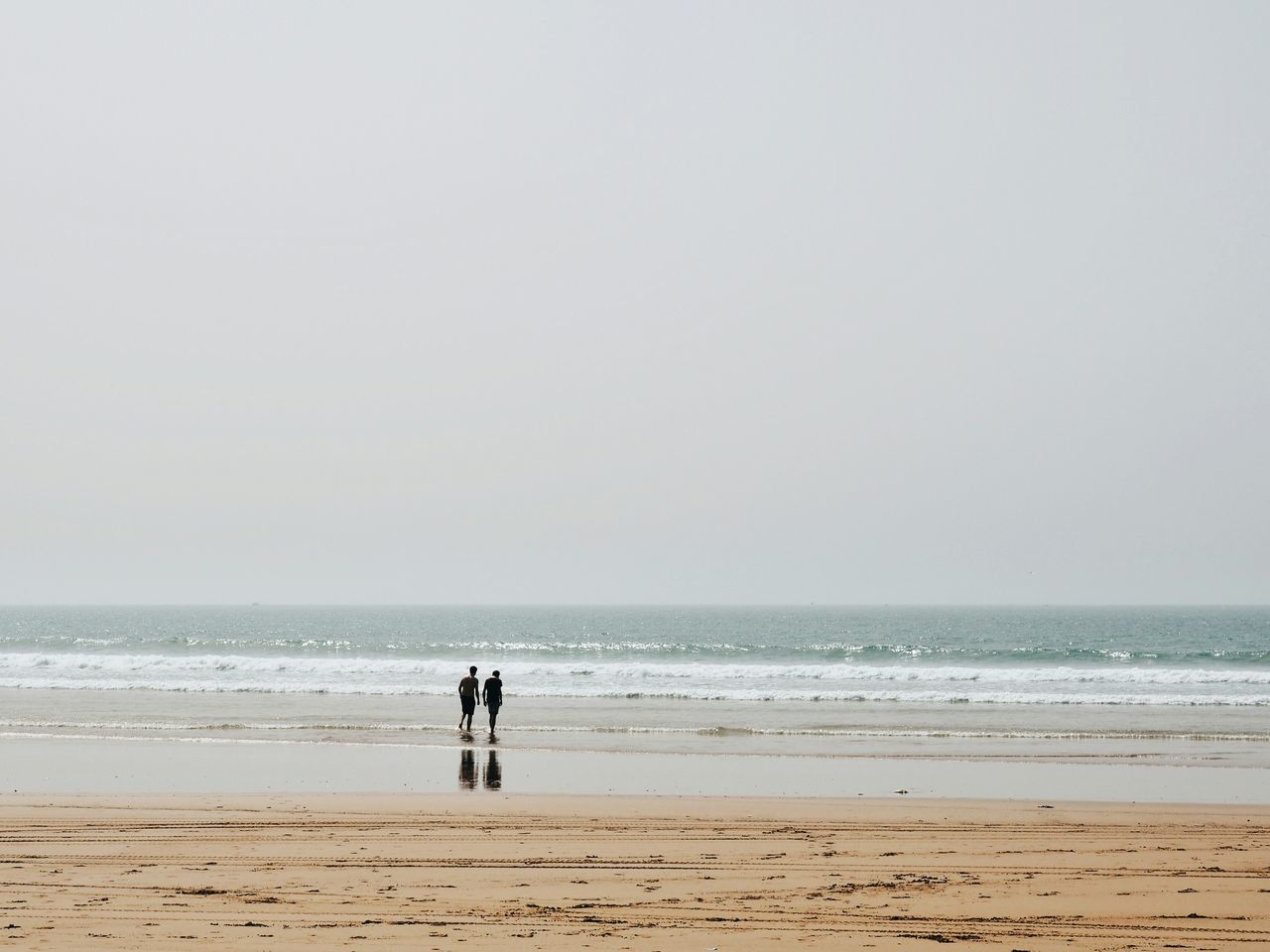 Beach Sea Sand Horizon Over Water One Person People Outdoors Real People Vacations Day Water Adult Adults Only Only Men Adults Only Taghazout Reflection Reflection_collection Silhouette Morocco Morocco 🇲🇦 Adult Scenics Tranquility Nature