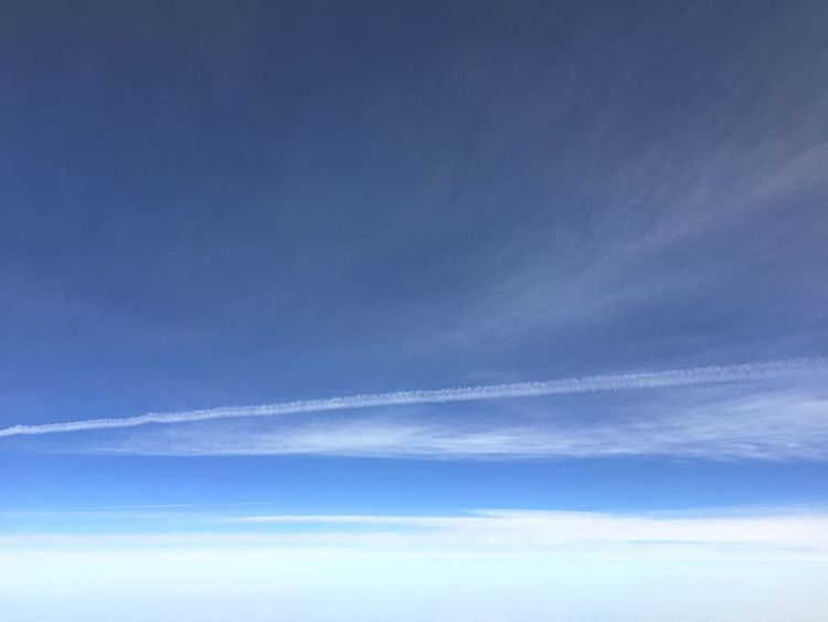 Beauty In Nature Sky Nature Scenics Blue Tranquility Cloud - Sky No People Low Angle View Tranquil Scene Sky Only Day Outdoors Backgrounds Vapor Trail Contrail
