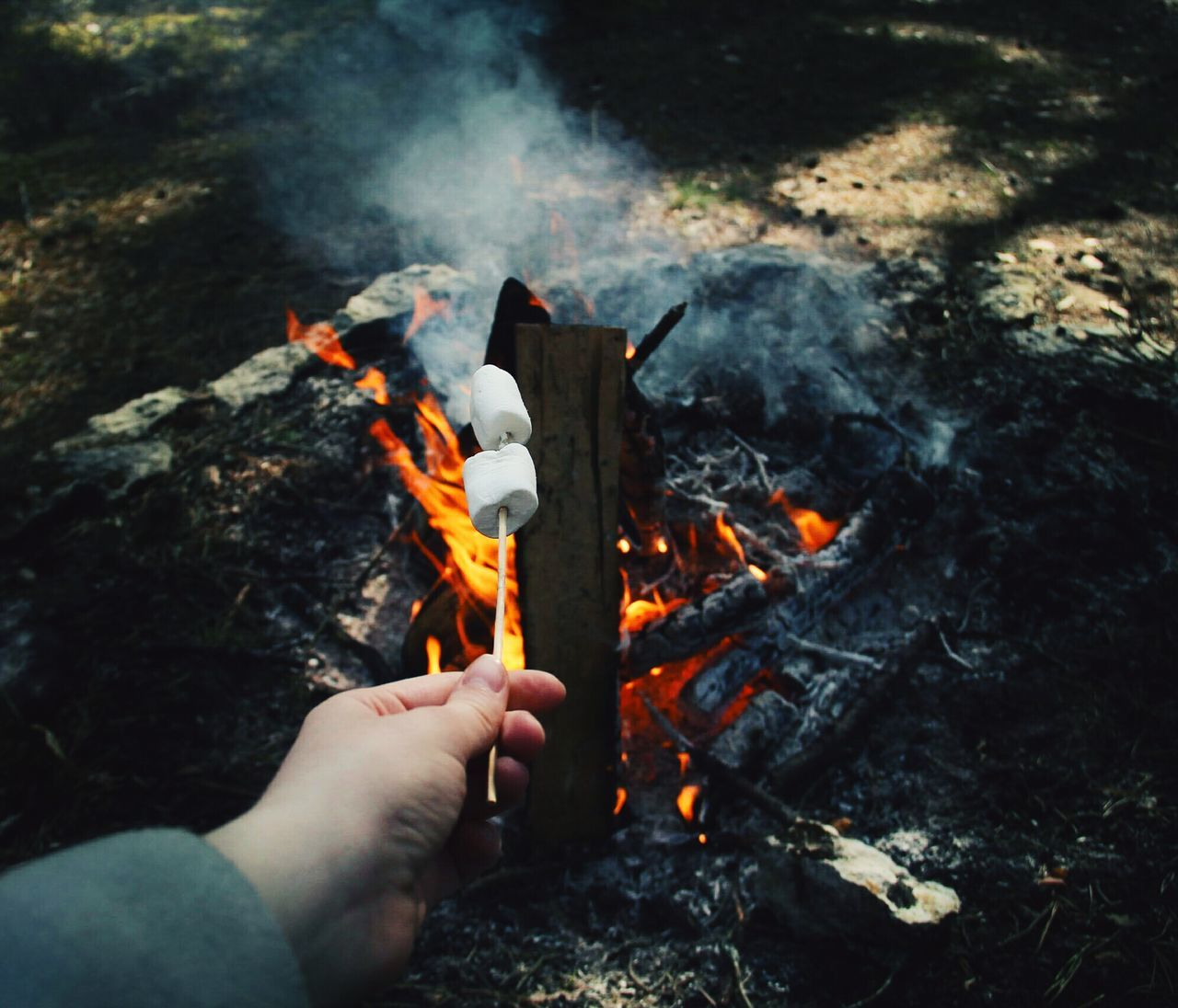 Human Hand Flame Burning Human Body Part One Person Heat - Temperature Holding People Smoke - Physical Structure Outdoors Bonfire One Man Only Real People Adult Campfire Adults Only Only Men Close-up Men Night