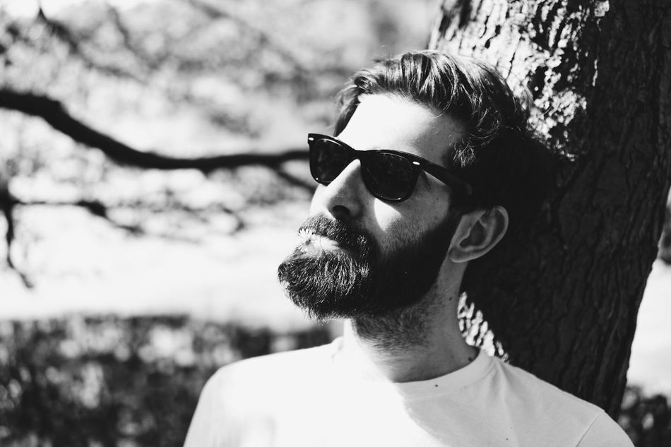 Sunglasses Real People Young Adult Young Men Outdoors Focus On Foreground Lifestyles Day One Person Headshot Tree Close-up Nature People Portrait Portrait Photography Flower Beard Real Photography Beauty In Nature Faces Of EyeEm Face Fashion