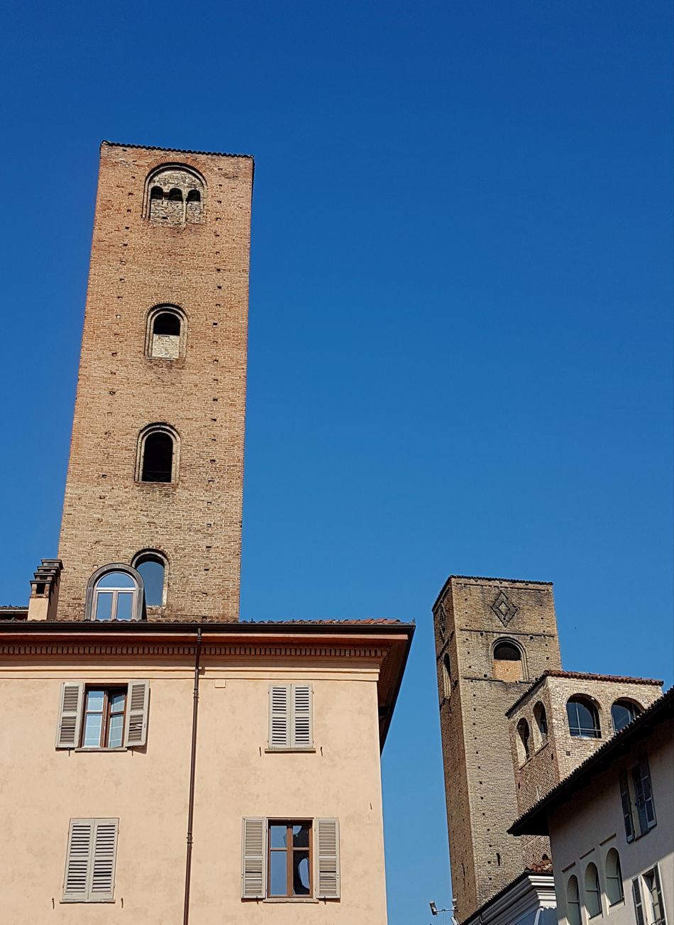 Blue Clear Sky Architecture Building Exterior Low Angle View Built Structure History No People Sky Day Outdoors Piedmont Italy Langhe Medieval Towers Historic City Travel Destinations