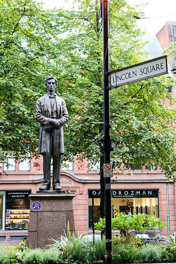 Abraham Lincoln Art Art And Craft Creativity Creeper Day Green Green Color Human Representation Memories Outdoors Pedestal Sculpture Statue Text Tree