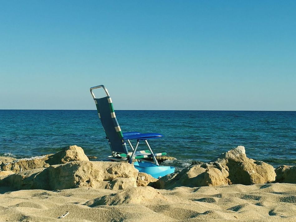"""Leave that chair alone on the beach"" Chair Beach Beachphotography Sea Sea And Sky Puglia South Italy Puglia"