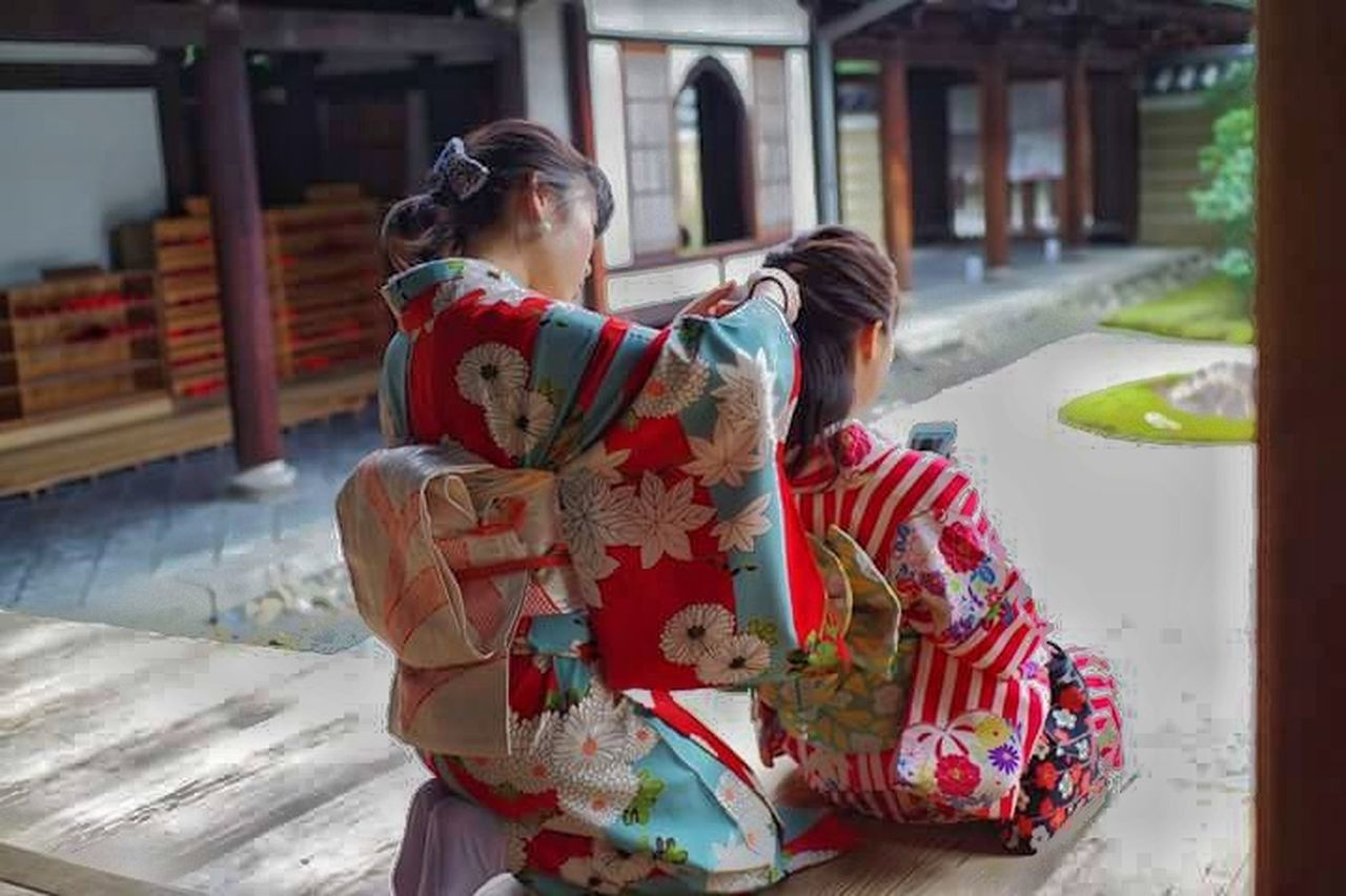 togetherness, two people, love, traditional clothing, kimono, real people, adult, bonding, building exterior, built structure, women, day, outdoors, people, architecture, only women, sari, adults only, young women, young adult, bride, warm clothing, reunion - social gathering