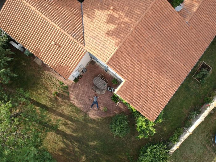 Architecture Building Exterior Built Structure Corrugated Iron Day Djispark Dronedji Dronephotography High Angle View House One Person Outdoors People Roof Tiled Roof