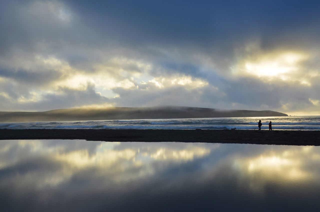 California Coast Cloudy Sky Moody Sky Silhouette Sunset At The Beach Water Reflections Beach Beauty In Nature Full Frame Sunset Sunset Over Water Sunset Reflection On Water