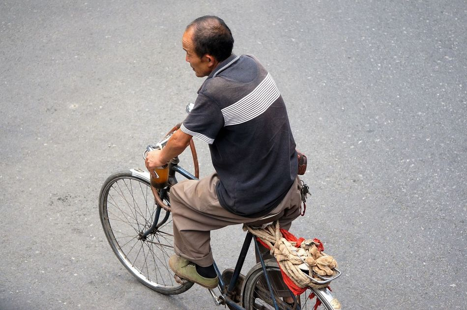 Balding Bicycle Casual Clothing China Chinese Man Cycling Day Journey Land Vehicle Man Cycling Mode Of Transport Movement On The Move Outdoors Riding Road Summer Transport Transportation Transportation Travel Travelling Vacations Work
