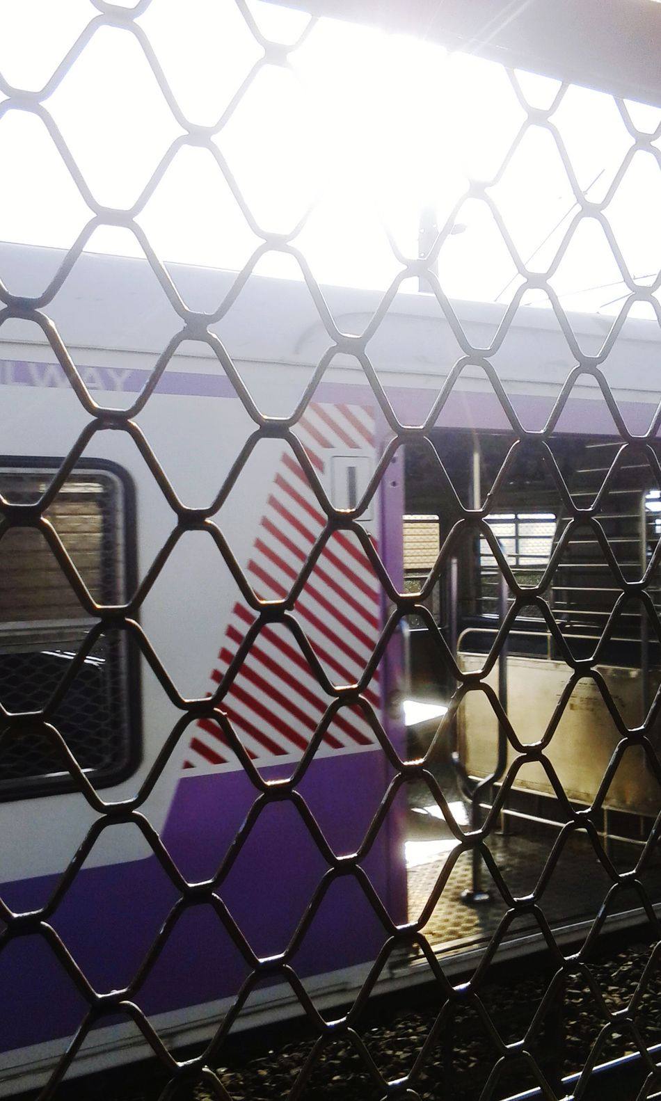 Picture of another local train CLICKED BY ME through the window i was travelling in. Local Western Line Trains as means of public transportation. Sunlight Through Windows From A Train Window Local Transportation Awesome_captures Behind The Grill VariousColors GoodMorning⛅ Sunlight ☀ Moving Fast Sunlight, Shades And Shadows Reflection_collection Trainphotography Light And Shadow Purple ♥ Shadowgraphy Metal Structure Random Shots Sunrise Train_of_our_world Trains_worldwide Trains & Railroad Click Click 📷📷📷 by AwesomeAisha_24 in Mumbai Maharashtra India