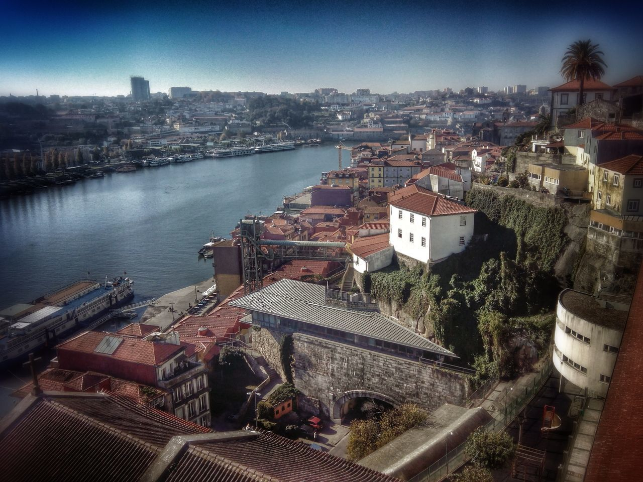 architecture, built structure, building exterior, high angle view, water, river, day, outdoors, cityscape, no people, city, roof, transportation, bridge - man made structure, travel destinations, tree, sky