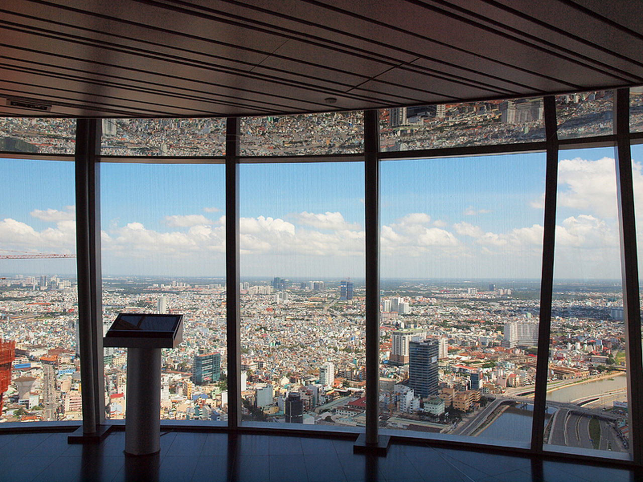 cityscape, window, sky, built structure, architecture, city, day, indoors, no people, cloud - sky, nature, sea, mountain, coin-operated binoculars, travel destinations, scenics, water, building exterior