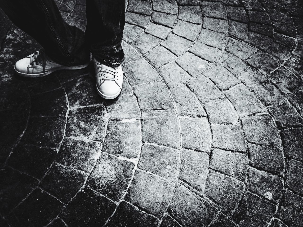 low section, shoe, human leg, one person, real people, standing, cobblestone, human body part, day, outdoors, men, close-up, adult, people
