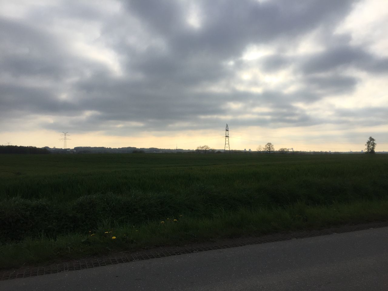 cloud - sky, sky, nature, field, sunset, tranquility, electricity pylon, tranquil scene, no people, technology, fuel and power generation, electricity, silhouette, scenics, beauty in nature, outdoors, agriculture, landscape, day, alternative energy, wind turbine, wind power, windmill, architecture, industrial windmill