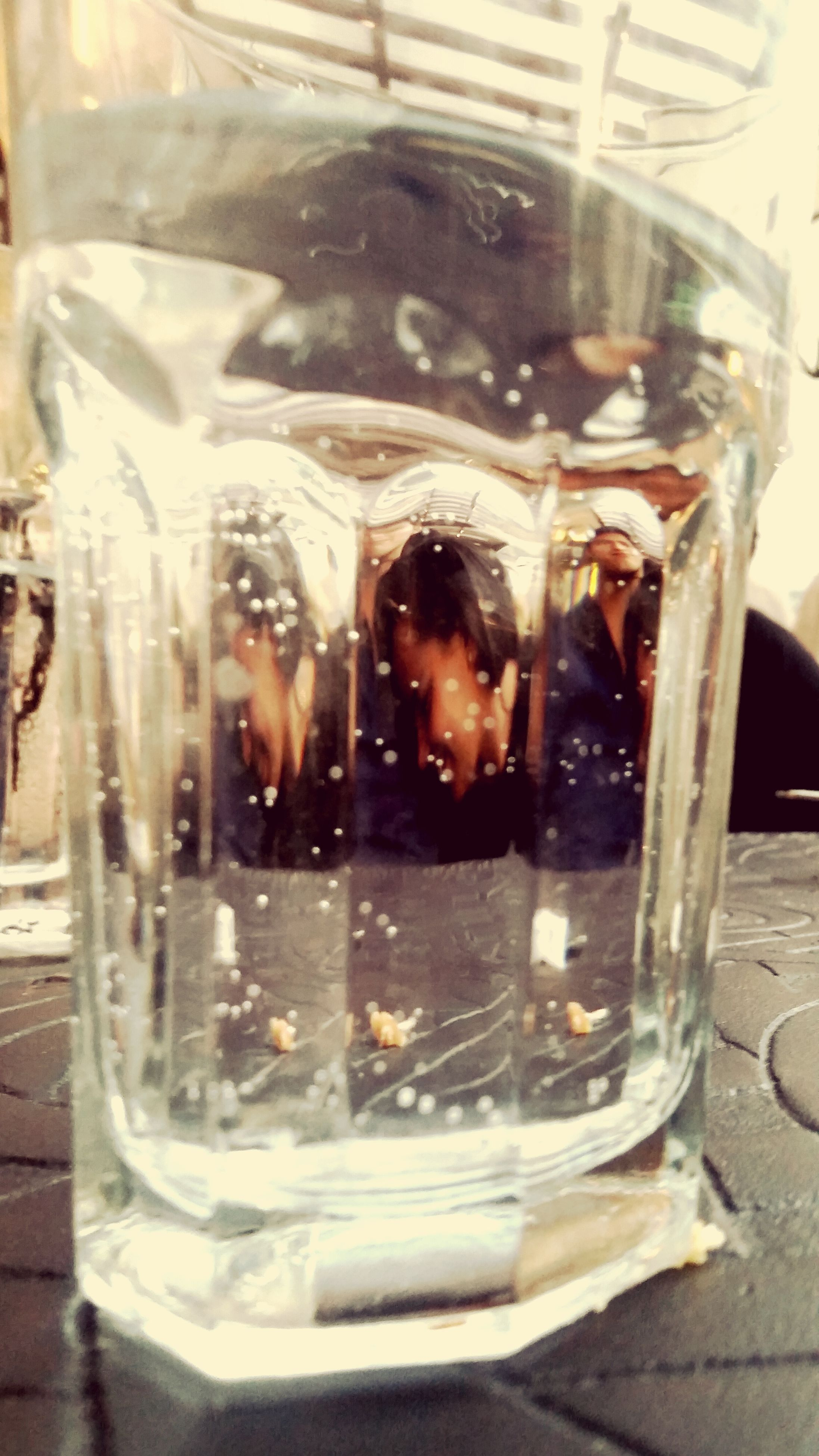 glass - material, transparent, indoors, glass, reflection, drink, window, wet, drinking glass, car, refreshment, lifestyles, food and drink, close-up, water, street, motion, leisure activity