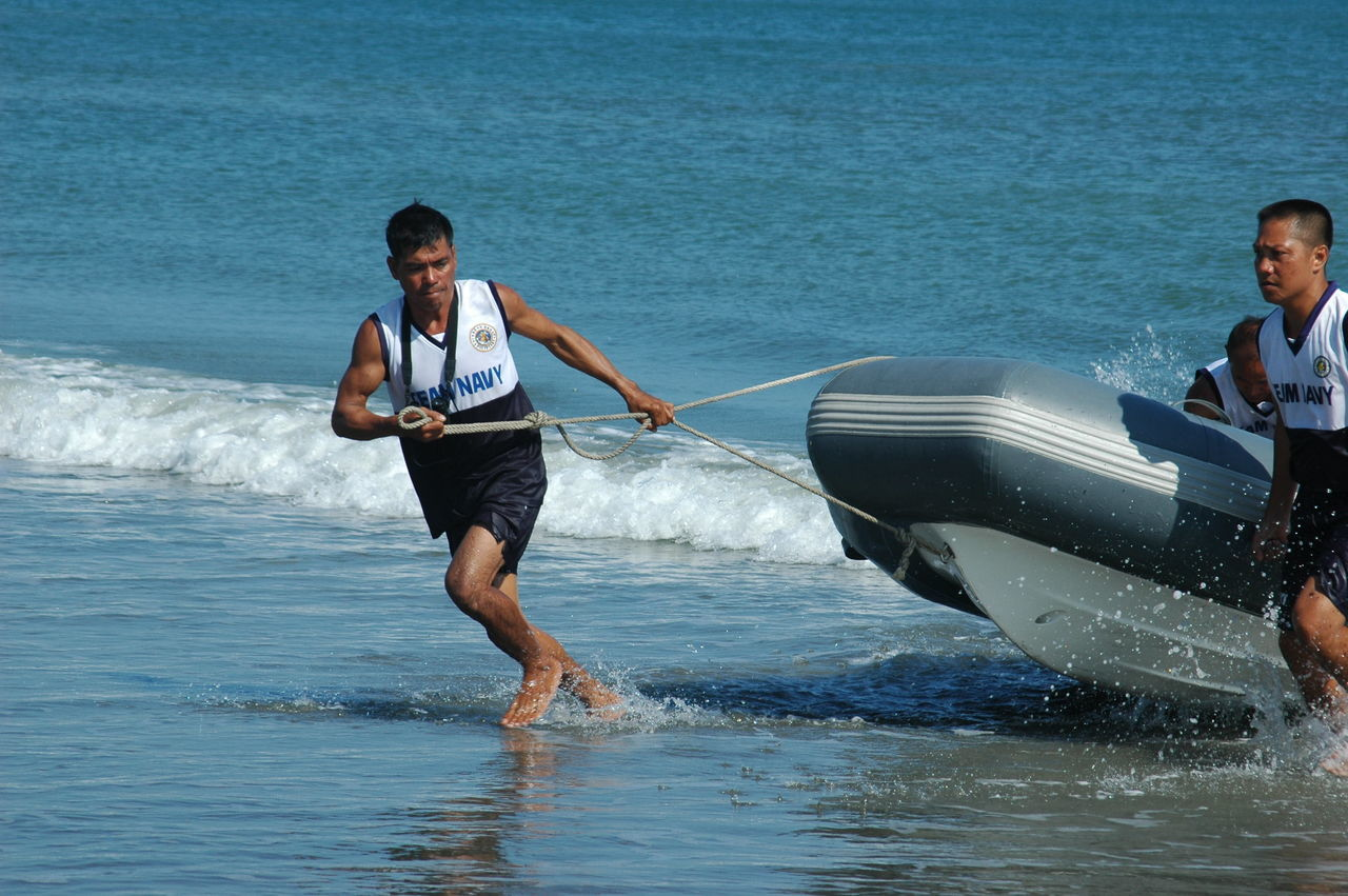 sea, real people, water, leisure activity, two people, men, young men, day, nature, young adult, beach, waterfront, togetherness, lifestyles, adventure, outdoors, full length, wave, ankle deep in water, sport, sky, adult, adults only, people