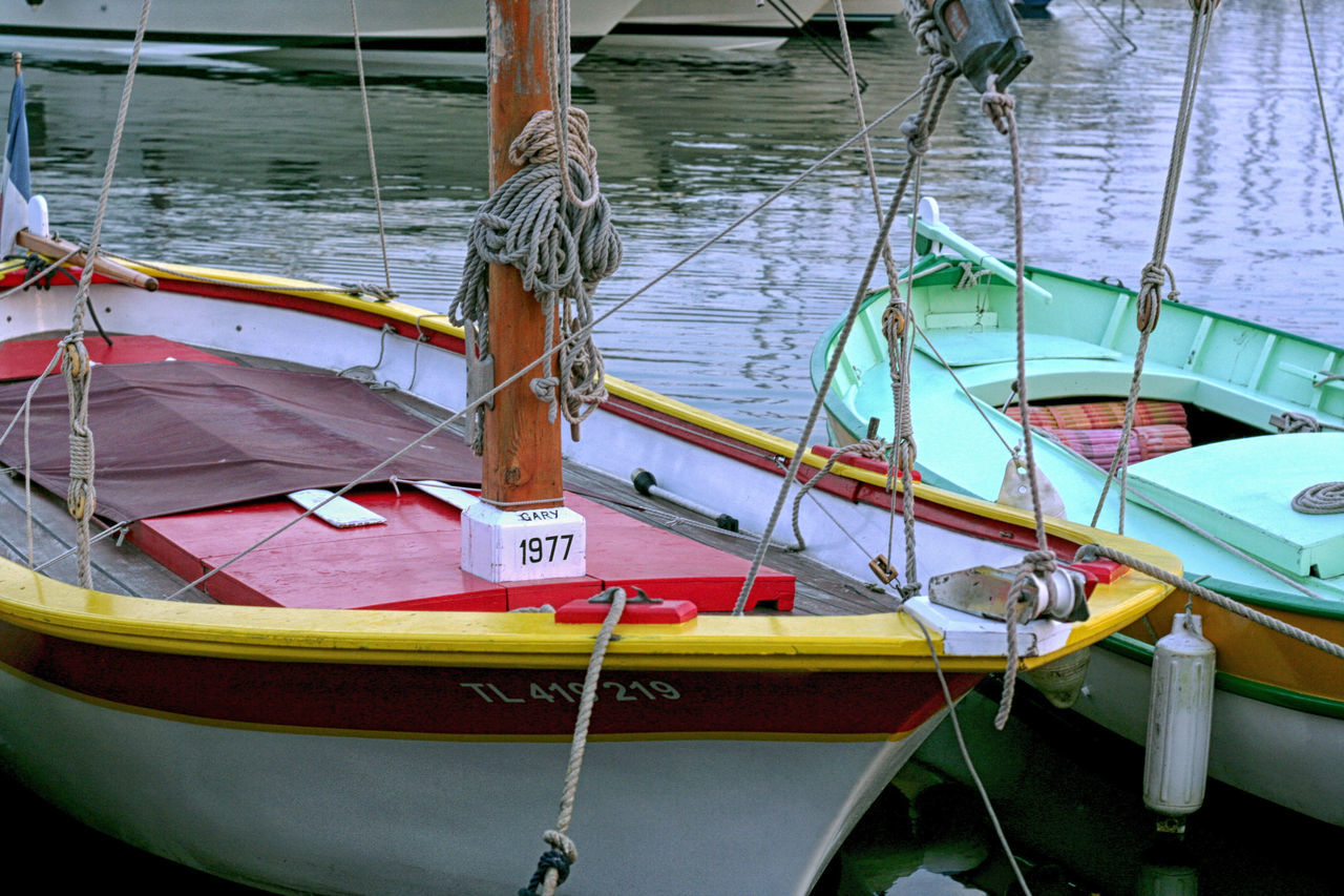 nautical vessel, transportation, moored, mode of transport, boat, water, rope, no people, day, sea, nature, outdoors, longtail boat, rowboat, outrigger, close-up