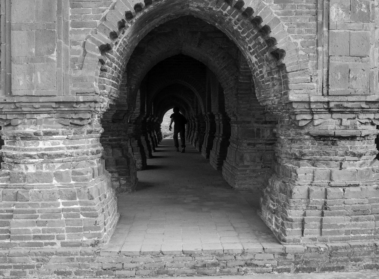 arch, built structure, architecture, history, real people, the way forward, day, one person, indoors, men, building exterior, full length, people