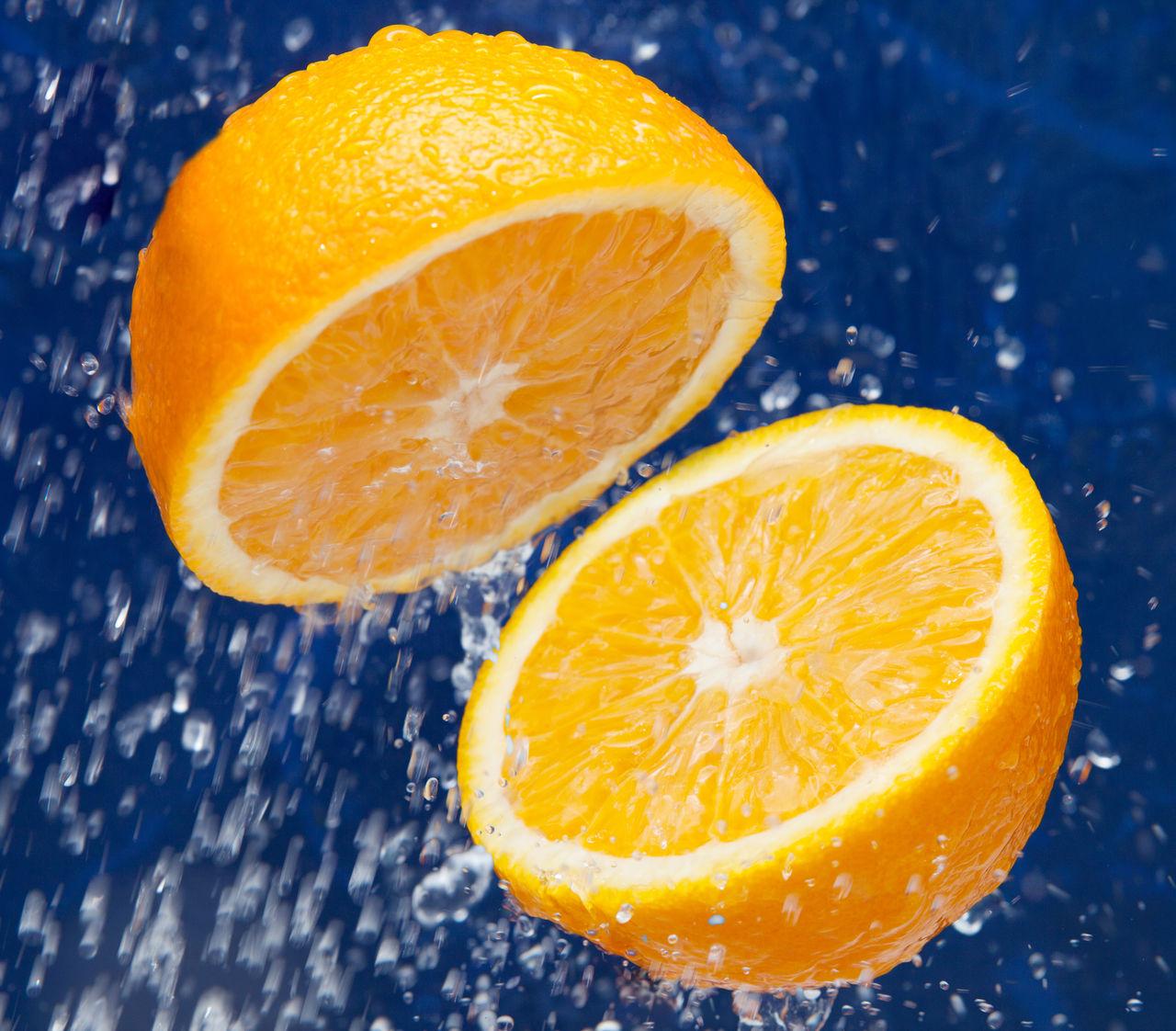 Fresh sweet orange with drops of water Blood Orange Citrus Fruit Close-up Cross Section Food Freshness Fruit Grapefruit Halved Healthy Eating Juicy No People Orange - Fruit Orange Color SLICE Sour Taste Studio Shot