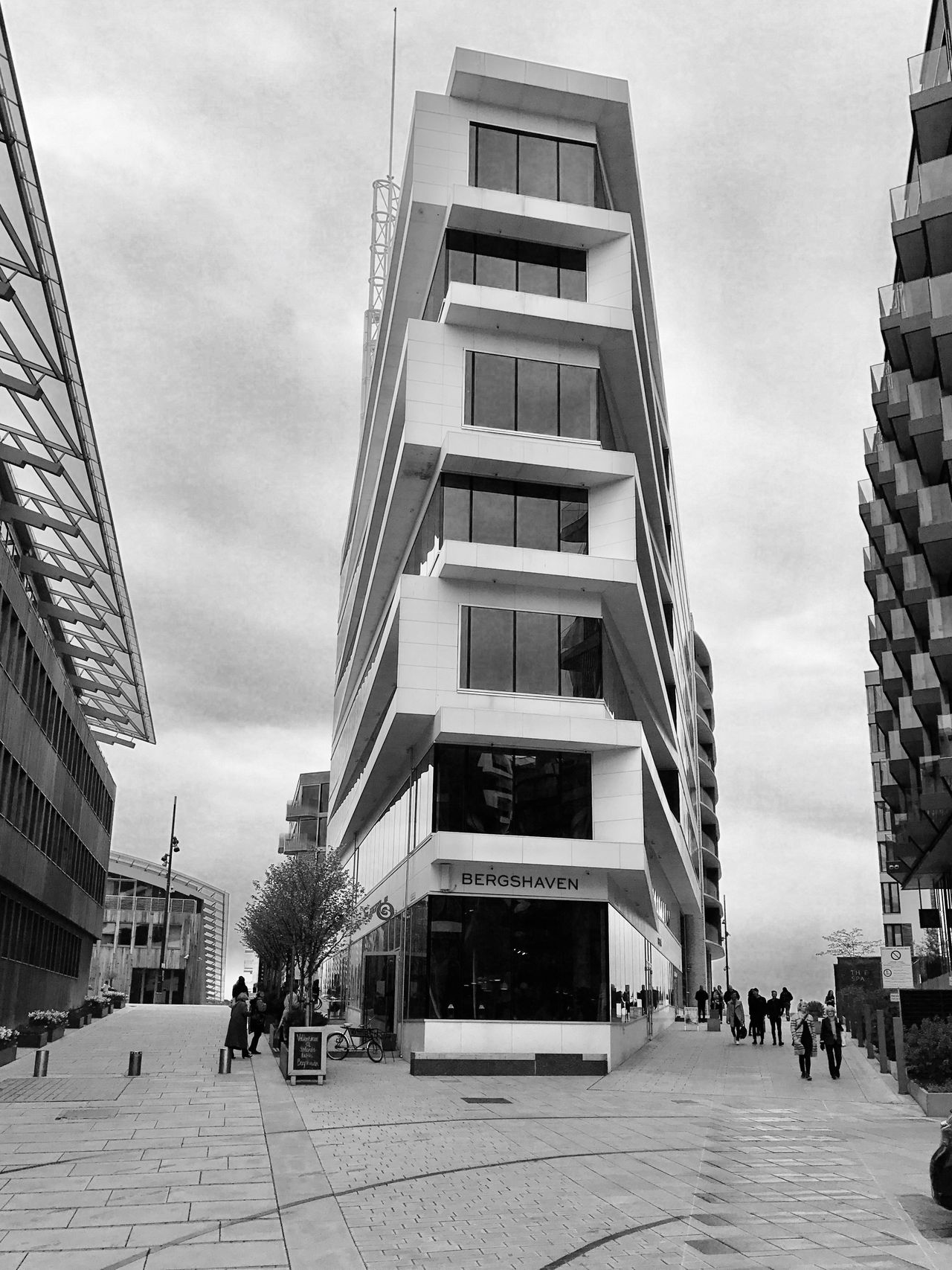 The Architect - 2017 EyeEm Awards Oslo Aker Brygge Architecture Built Structure Building Exterior Walking Sky Modern City Day Real People Men Skyscraper Low Angle View Outdoors Large Group Of People People Adult Adults Only Bnwlovers Bnw