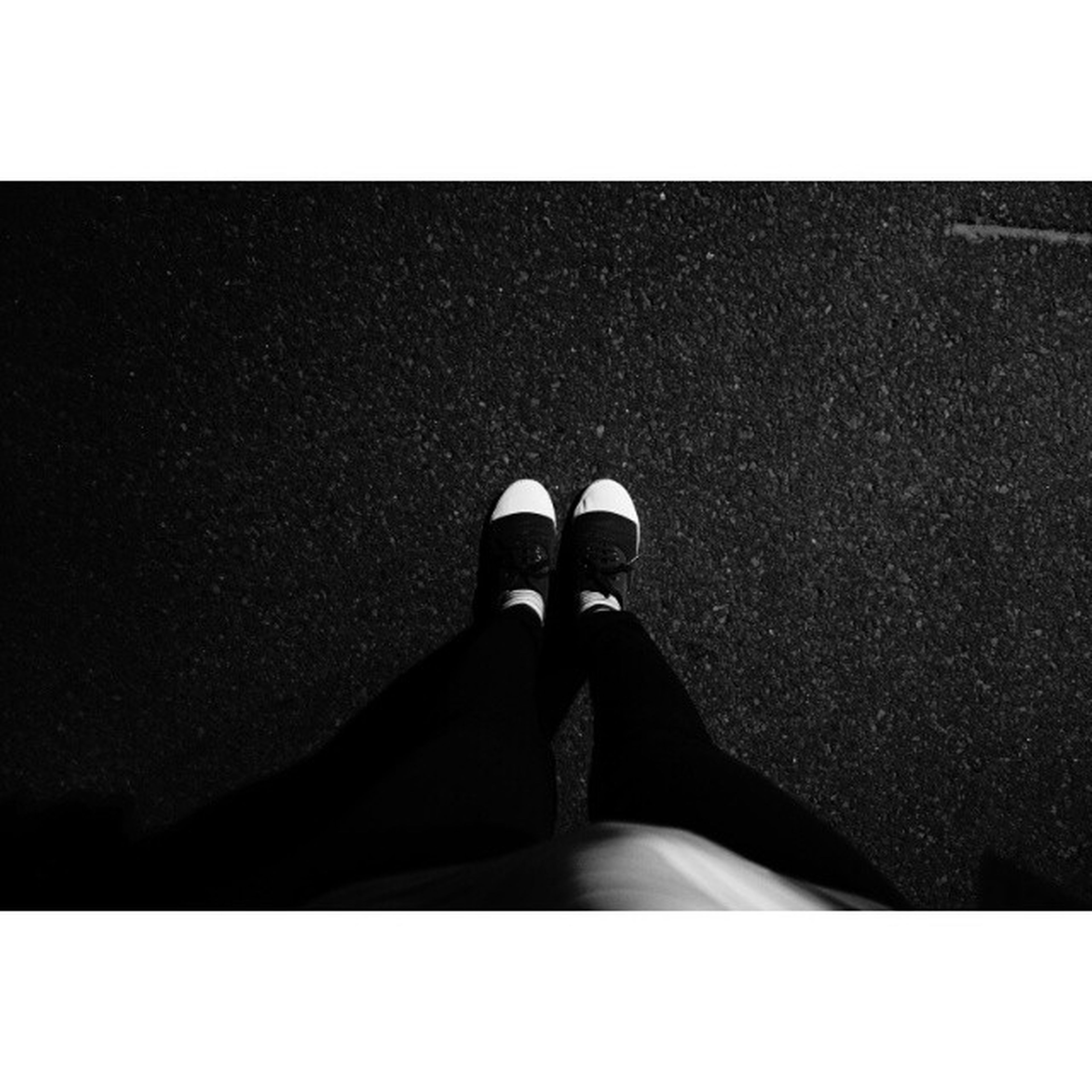 transfer print, auto post production filter, low section, person, shoe, personal perspective, footwear, copy space, lifestyles, high angle view, street, standing, part of, human foot, day, road, shadow