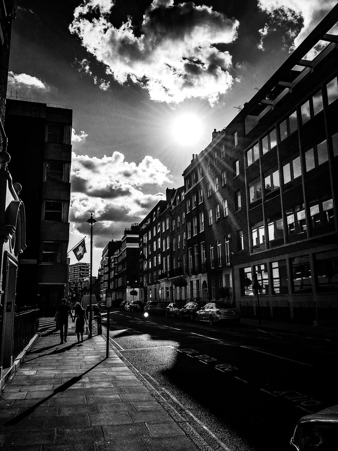 Couple Walking Hand In Hand Black And White Dark Sun Artistic London Showcase July The Week Of Eyeem Architecture Cloudporn Urban Exploration Creative Photography Windows Fine Art Fine Art Photography Clouds Reflections Streetphotography
