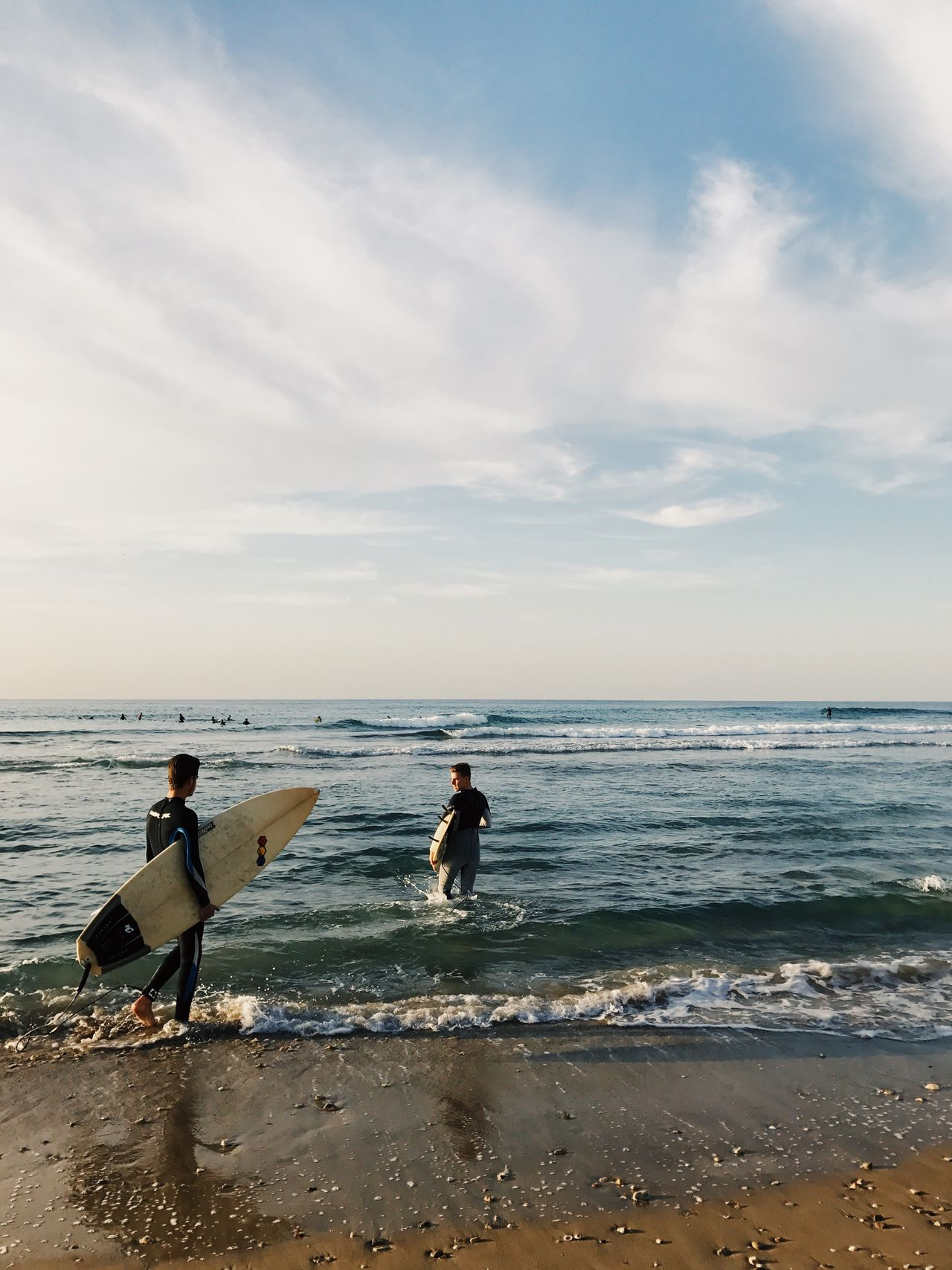 Sea Beach Sand Horizon Over Water Shore Water Wave Real People Surfboard Nature Sky Beauty In Nature Scenics Two People Standing Leisure Activity Men Cloud - Sky Vacations Full Length מייים Shotoniphone7plus מייאייפון7 IPhone7Plus The Great Outdoors - 2017 EyeEm Awards