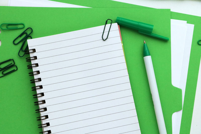 Close-up Day Desk Desktop Education Folder Green Color Indoors  No People Note Pad Notebook Office Office Supply Paper Paper Clip Place To Write Spiral Notebook Thoughts Writing